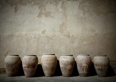 Pots in Nizwa fort, Oman (Eric Lafforgue) Tags: castle tourism wall fort arabic pot arabia arabian peninsula oman ramadan mur vases poterie nizwa omn  omani arabie   lafforgue  9346 om  omo umman omaan   omanais   omna omanas umn