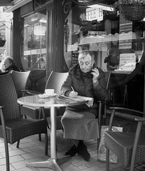 the crossword solver (jackeeadio) Tags: ireland people blackandwhite woman cafe candid crossword coffeeshop belfast northernireland campbells ulster streetshot