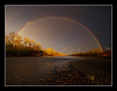 American River Rainbow (Tony Immoos) Tags: california lighting sunset sky storm water sunshine rain clouds wow river landscape gold amazing rainbow glow landmark olympus explore sacramento e3 sacramentocounty 1000views americanriver californialandscape zd olympuse3 918mm