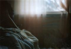 not-so-ghostly (kaleidoscope bones) Tags: film window girl 35mm bedroom sara doubleexposure naturallight curtains vivitar 400iso 50mmlens