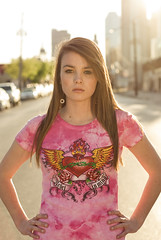 Standing Her Ground (Wade Griffith) Tags: street city pink portrait girl beauty fashion youth outdoors 50mm dallas clothing women designer models tshirt teen shirts backlit katydid deepellum sacredheart wadegriffith2010