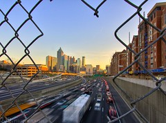 Looking south... Downtown Atlanta Sunset (HisPhotographs.com) Tags: city atlanta sunset sky motion blur cars skyline canon fence buildings georgia landscape high wire downtown traffic dynamic angle atl wide bluesky line land shooting through southeast scape range 1022mm hdr clearsky atlantageorgia xsi hotlanta trafic lightroom uwa photomatix uniqueshot citysunset 450d viewofdowntown trafficinmotion georgiatechdorms