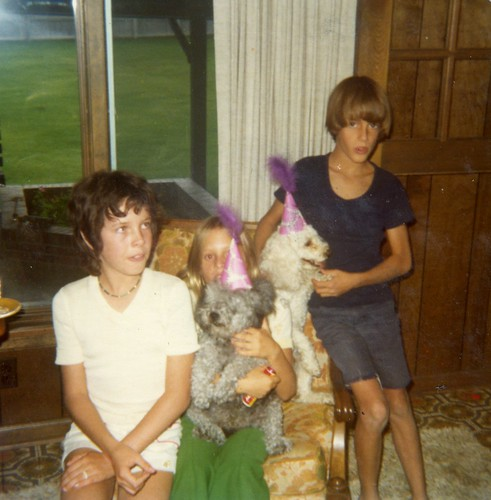 Michele and Tyson holding Rascal and Sandy at Carmel's first birthday party - August 15, 1975