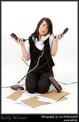 Attractive young brunette business woman with three telephones. (Ian M Butterfield) Tags: woman white girl lady female hair person one 1 three office women call commerce technology phone adult telephone young communication equipment business whitebackground attractive workplace brunette calling adults stress trade bodypart youngwoman technologies communications phones documents calls telephones dossier caucasian singular overworked telephoning businesswoman modelrelease phoning landline dossiers lateteens lightskin whiteperson documentwallet documentfolders photoimb documentfolder documentwallets fb0527be02856 e02856 fb0527b