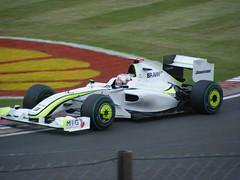 Jenson Button takes some kerb at Abbey
