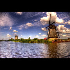 Kinderdijk 1 (genevieve van doren) Tags: sky reflection water netherlands clouds river bravo eau rivire unesco ciel nuages mills paysbas hdr kinderdijk lek patrimoine moulins newvision patrimonium colorphotoaward alemdagqualityonlyclub vosplusbellesphotos saariysqualitypictures onfrontpage obramaestra peregrino27newvision