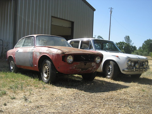 Heres the 66 Alfa GT, next to Luigis awesome column shift TI. Paint is obviously bad but the body is pretty straight.