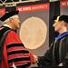 Chancellor Randy Woodson (left) congratulates a doctoral graduate student.