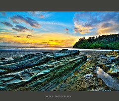 Another Rocky Sunset (Nazar's Collection) Tags: blue pakistan sunset newzealand green texture yellow rocks auckland abbas hillsborough nazar sigma1020mm wattlebay nazarab nazarabbas