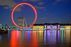 London Eye at Night (Philipp Klinger Photography) Tags: county uk blue red 2 chimney england sky motion color colour reflection building green london eye water westminster wheel yellow thames architecture night reflections river aquarium licht boat hall interestingness nikon colorful europa europe long exposure ship purple britain crane united tripod great illumination 8 kingdom londoneye ferris victoria valentine illuminated explore spinning britis
