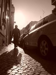 The Man who Walks Alone ... (K@spa) Tags: street city shadow blackandwhite bw sun man art cars silhouette sepia walking geotagged faro alone walk sombra pb sidewalk walkway below algarve joo kspa psychoint kasparow digitalcompactcamera sonycybershotw170 jooreganha ruaslus reganha themanwhowalksalone