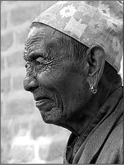 Man from Patan(Nepal), who looked like a sculpture. (Sukanto Debnath) Tags: old nepal portrait bw white man black face asian sony traditional rings cap ear nepalese ethnic patan f828 wrinkle debnath sukanto sukantodebnath