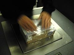 FedEx lady applying the airbill