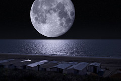 A Romantic Night at Sea (Bart van Damme) Tags: moon reflection beach night thenetherlands craters northsea twopeople romanticism surealism bloemendaalaanzee zandvoortaanzee beachcondos mywinners supermoon bartvandammephotography bartvandammefotografie emailbagtvandammegmailcom