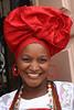 A smile from Bahia (Bertrand Linet) Tags: red brazil portrait smile hat brasil bresil bahia salvador baiana earing salvadordabahia bertrandlinet