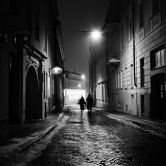 Vilnius (Peter Gutierrez) Tags: photo europe european eastern baltic lithuania lithuanian lietuvos vilnius vilna wilno street sidewalk pavement public old ancient medieval city urban town center centre nighttime night time nocturne nocturnal nacht notte noche nuit evening dark light shadow black bw white square format peter gutierrez petergutierrez film photograph photography