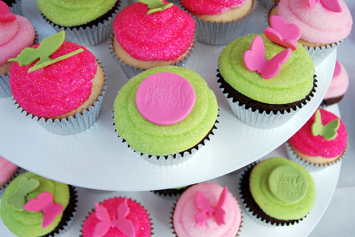pink and green first birthday cupcake tower cupcake view
