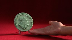 STRIDE® Gum Nonstop Mint™ Commemorative Coin (Stride Gum) Tags: money gum hand candy display mint commercial chewinggum nonstop infomercial stride redbackground minted commemorativecoin stridegum winfomercial gumcoin nonstopmint