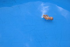 (Heidelknips) Tags: blue cloud baby water 35mm doll swimmingpool morbid d90