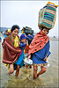 RETURNING HOME IV (Apratim Saha) Tags: blue portrait people woman india man color festival river painting nikon indian nikond70s oldwoman balance dailylife kolkata 1870mm pilgrim ganga nationalgeographic ganges mela westbengal 1870 saha northindia siliguri gangasagar mywinners colorphotoaward apratim lifeinindia earthasia gangasagarmela lifeculture apratimsaha