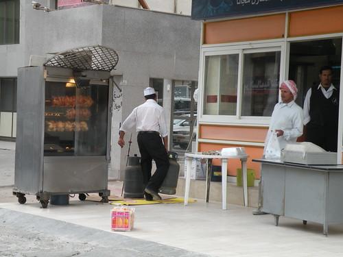food chicken cooking restaurant workers outdoor gas cylinder kuwait grilled cooks kuwaiti