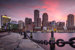 Boston Financial District Skyline (Jim Boud) Tags: bridge sunset water boston skyline architecture clouds buildings lens boats is downtown cityscape skyscrapers dusk massachusetts smooth dramatic wideangle chain financialdistrict usm artisticphotography reflectin 1518 jimboud canoneos60d jamesboud canonefs1585mmf3556isusm canon1585mm