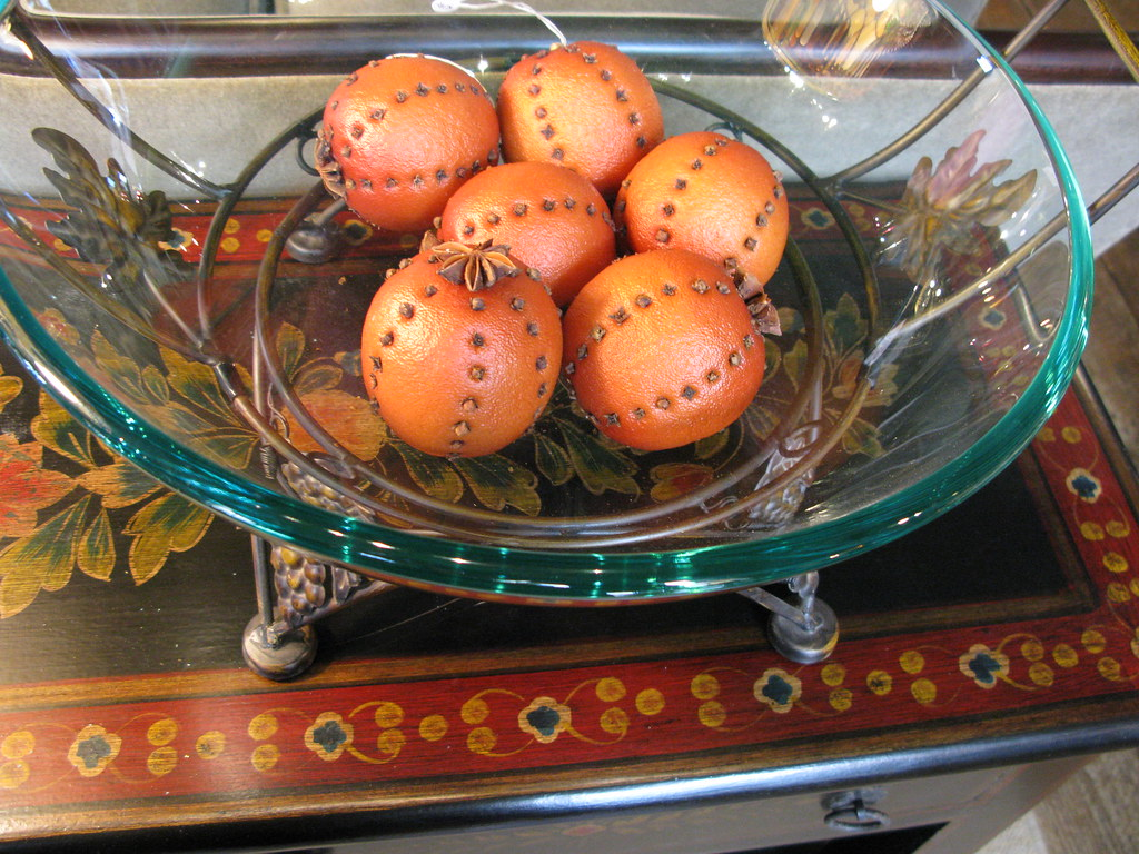 This Table is painted with a border in complementary colors.  A bowl of Orange Pomanders.