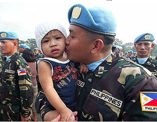 Philippine peacekeeping force kissing his son before going to Haiti