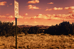 Highway 54 Revisited (Parabola-Pop) Tags: road new trip sunset vacation sky orange mountains sign clouds d50 landscape mexico nikon taos