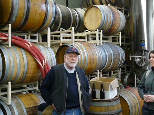 Owner Art Larrance with barrels of goodness at Raccoon Lodge/Cascade Brewing in Portland.