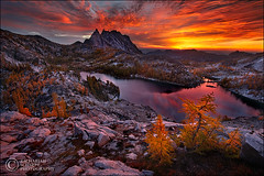 Blazing Enchantments (reprocess) (Zack Schnepf) Tags: autumn red mountain lake reflection fall rock sunrise landscape washington warm searchthebest rocky peak cascades granite zack larch epic northerncascades prusik enchantments schnepf enchantmentlakes westernlarch goldenlarch perfectionlake subalpinelarch