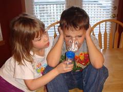 Mallory giving Pablo a nebulizer treatment.