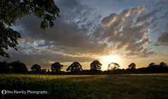 SETTING SUN. (Des Hawley) Tags: trees sunset england sky sun sunlight nature beautiful field clouds landscapes cool nikon shadows village cheshire awesome cereal explore sunrays 157 d300 lymm coth supershot thegalaxy naturesgarden superhearts platinumheartaward absolutelystunningscapes deshawley andromeda10 postie22