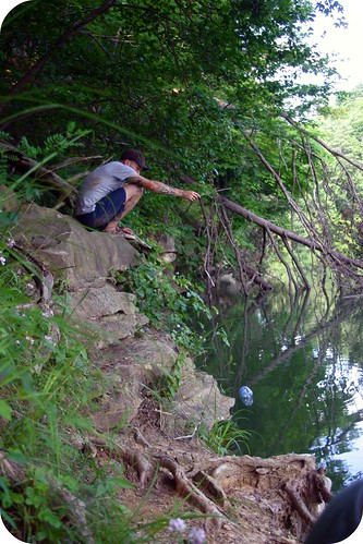 Fishing with a bottle, string, stick and bait.