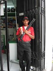 Icecream with a smile. ....and a Shotgun. (Ben Canales) Tags: smile happy dangerous gun cops guatemala guard police security icecream cop shotgun armed guatemalan icecreamcone bencanales