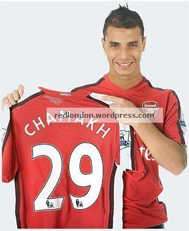 Chamakh holding up his Arsenal shirt (mock pic)