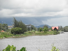 Looming Rain Heading For Kinarut (thienzieyung) Tags: trees water sign clouds danger warning dark bay afternoon cloudy streetlights places hills shore malaysia kotakinabalu sabah teluk rhu lokkawi putatan thienzieyung dumpil