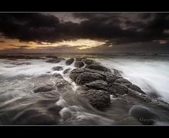 Rocky Outcrops (danishpm) Tags: ocean seascape beach rock clouds sunrise canon wave australia wideangle nsw aussie aus 1020mm manfrotto sigmalens kingscliff eos450d 450d kingcliff tweedshire dragondaggerphoto sorenmartensen hitechgradfilters 09ndreversegrad