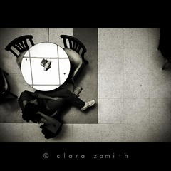 For the price of a cup of tea (Clara Zamith) Tags: travel bw woman coffee monochrome up lines canon table rebel cafe chair do view tea squares geometry stranger pb aerial photograph converse allstar campos upon jordo xti 400d clarazamith