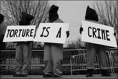 """Torture is a Crime"" (The Voice of Eye) Tags: people usa history fashion sign outdoors photography washingtondc democracy menacing neworleans political politics protest performance performing culture thoughtful documentary bodylanguage posing overcast communication identity portraiture torture editorial determined costuming humanrights subversive activist symbolic symbolism greyscale unsettling despondent sociology humaninterest hopeful participation thewhitehouse inyourface socialissues irreverent actuality conscientious lifeasart environmentalportraiture noapologies craigmorse culturesubculture washingtondcdistrictofcolumbia closeguantanamo blackandwhiteblackandwhitebw blancoynegroblancoynegro thevoiceofeye forsakennotforgotten neroebianconeroebianco noiretblancnoiretblanc pretoebrancopretoebranco schwarzesundweischwarzesundwei zwarteenwitzwarteenwit customsandtradition presidentialinauguration2009"