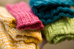 02.01.2009: coloury projects (bookgrl) Tags: socks knitting bright knitted mitts thuja recentprojects calorimetry darksidecowl yip2009 yipkc