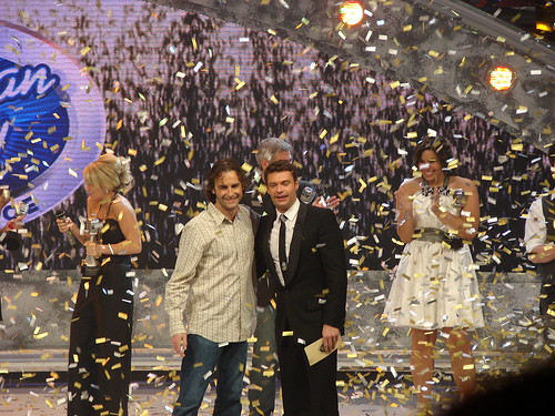 Mark Ellis celebrates his win with Ryan Seacrest. Photo by Mark Goldhaber.