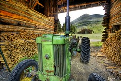 John Deere at the Ranch (Stuck in Customs) Tags: lighting wood light wallpaper chimney brown tractor green art texture nature colors beautiful modern composition reflections john painting fun photography amazing cool intense nikon perfect montana exposure shoot artist mood photographer shot angle bright image farm vibrant unique background d2x perspective picture surreal atmosphere edge processing stunning pro resolution yellowstone wyoming framing portfolio lovely capture emotions tones magical firewood hdr deere johndeere masterpiece treatment stuckincustoms treyratcliff silvertip2
