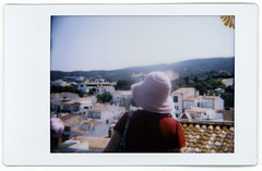 Alexis observes Cadaques (thirtyoneteeth) Tags: alexis skyline spain diana dianaf cadaques instax instaxmini flybutter instaxback dianainstaxback