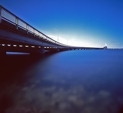 Newport Bridge::En Azul (Dr. RawheaD) Tags: ocean longexposure bridge blue sky water fuji f45 hasselblad rhodeisland velvia newport 50 hoya carlzeiss 38mm biogon nd400 nd8 superwidec