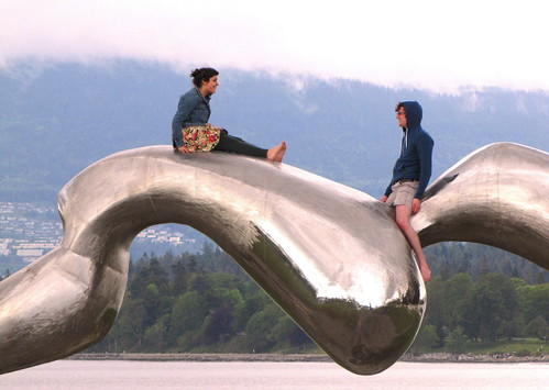 A couple on Frozen Liquid sculpture in Vancouver's Vanier Park
