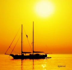 Sun bathing... (Aster-oid) Tags: reflections boats silhouettes sunsets greece sailboats masts mykonos frontpageexplore mywinners ff43 theperfectphotographer