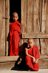 Asia -  Myanmar / Burma (RURO photography) Tags: voyage travel boy red portrait people cute male tourism boys beautiful smile face kids canon children temple photography asia asien child faces asahi photos retrato buddha burma religion kinderen culture monk buddhism reis nios kind monks portraiture myanmar enfants lonelyplanet criana portret enfant nio birma lightandshadow klooster homme garon bagan tempel nationalgeographic cultuur reizen discoverychannel azi monnik religie boeddha mannelijk gesichter godsdienst boeddhisme supershot kartpostal lichtenschaduw enstantane  voyageursdumonde eperke journalistchronicles globalbackpackers discoveryphoto discoveryexpeditions rudiroels