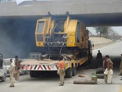 stuck under (tango 48) Tags: bridge pakistan yellow truck underpass crane avenue islamabad flatbed