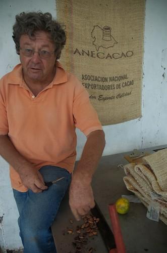 Samuel examining fermented beans.